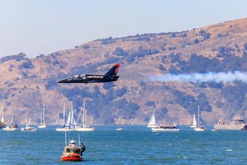 Patriots Jet Team aerobatic team Aero L-39 Albatros jet flying over the San Francisco Bay in California, USA