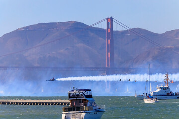 Patriots Jet Team aerobatic team's Aero L-39 Albatros jet flying under the Golden Gate Bridge in San Francisco, USA