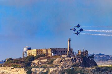 United States Navy Blue Angels aerobatic team's F-18 Hornet combat jets at Fleet Week San Francisco over Alcatraz Island