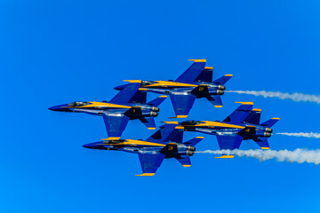 United States Navy Blue Angels aerobatic team's F-18 Hornet combat jets In flight at Fleet Week San Francisco, USA