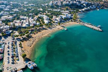ELOUNDA, CRETE, GREECE - 27 AUGUST 2020: Aerial view of the public beach in the popular Greek...