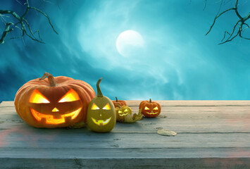 A pumpkins head jack o lantern on wooden table .Halloween background.