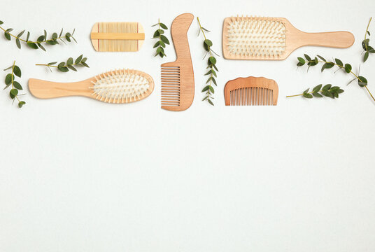 Flat lay composition with modern hair combs and brushes on white background. Space for text