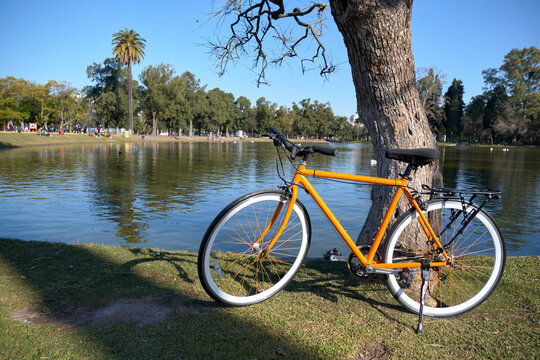 Orange bicycle next to a lake in Buenos Aires, Argentina