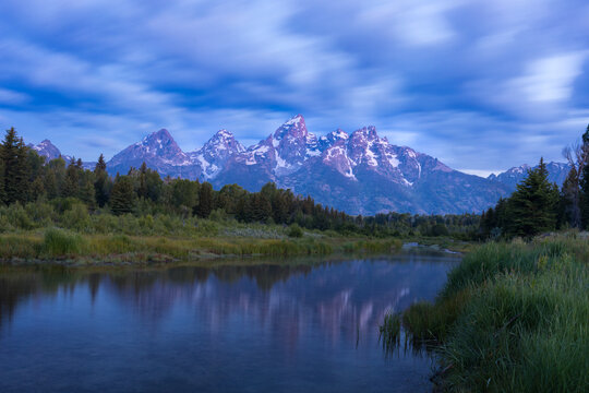 Scenic view of Schwabacher Landing and Snake River with mountains in background