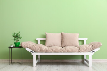 Stylish modern sofa in room