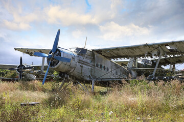 Abandoned old small propeller plane. Airplane graveyard