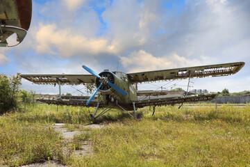 Abandoned green small propeller plane. Airplane graveyard