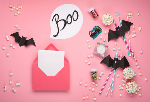 Halloween decorations on pink background. Halloween holiday concept. Flat lay, top view