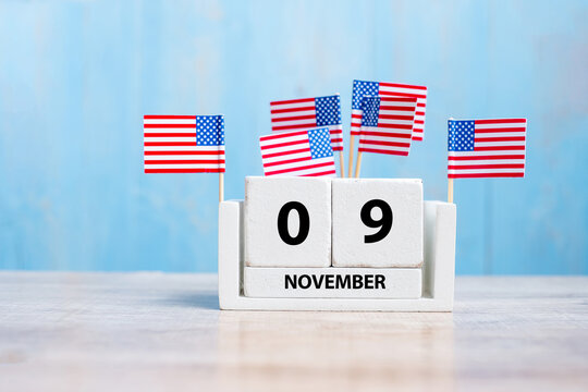 9 November of white Calendar with United States of America flag on wood background. Veterans day 2020 and Holiday concept