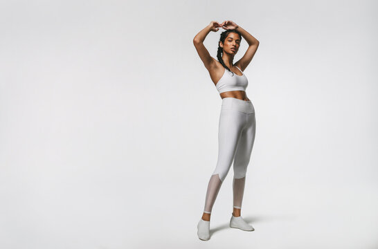 Fitness woman working out on white background