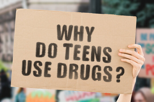 "The question "" Why do teens use drugs? "" on a banner in men's hand with blurred background. Addiction. Care. School. College. Negative impact. Friends"