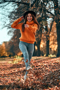 Woman in park in autumn
