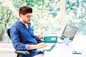 Shot of casual businessman working at office desk