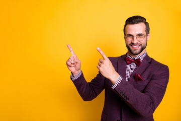 Portrait of his he nice attractive cheerful cheery glad guy pointing two forefingers up copy space like follow subscribe advert isolated over bright vivid shine vibrant yellow color background