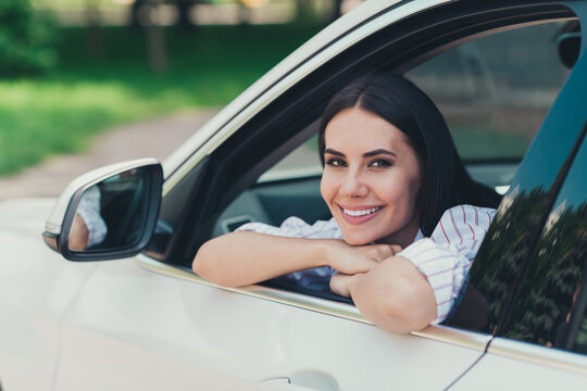 Close-up portrait of her she nice attractive gorgeous lovely pretty cheerful content lady enjoying riding cool white vehicle motorway good mood suburb way road