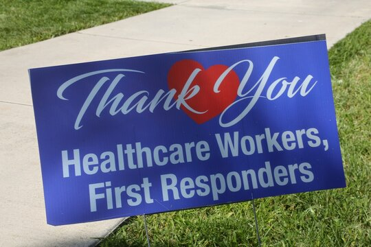 """Thank You Healthcare Workers, First Responders"" Sign in the Grass Next to the Emergency Room of a Hospital during the Coronavirus Pandemic"