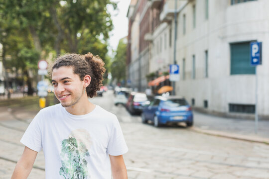 Young man posing in the city streets