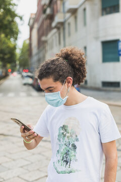 Young man wearing mask in the city streets