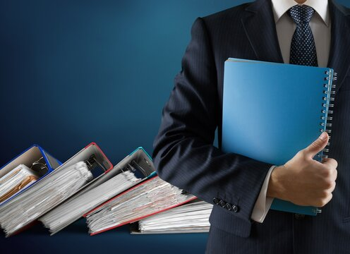 File folders with documents and business man