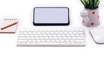 Workspace concept with blank screen smartphone, mouse and keyboard on  white top table.