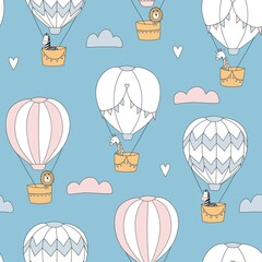 Cute seamless pattern with animals on balloons.