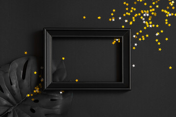 new year and christmas black background and gold decorations. background for text in a frame for a party