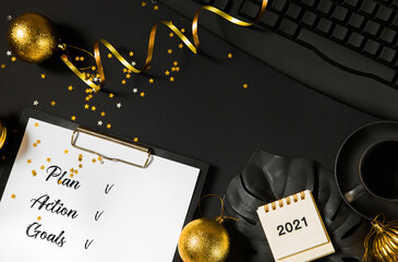 Black office desk, new year and christmas eve. Plans and goals for the next year 2021.