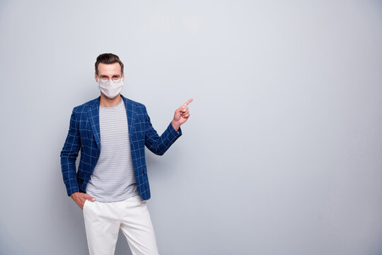 Portrait of his he attractive classy healthy content guy employer wearing safety mask showing advice mers cov infection prevention human health care isolated light grey pastel color background