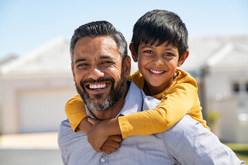 Happy Indian parent with child on back