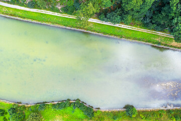 a created waterway from above with a natural shore