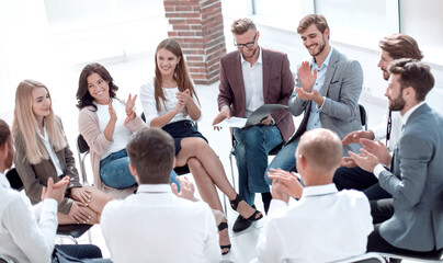 corporate team votes during a business meeting.