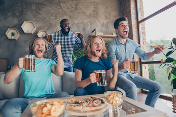 Portrait of four people excited guys meeting sit home couch watch world final cup match support...