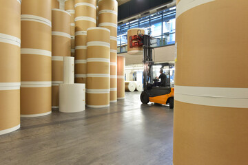 Storage of paper rolls in a large print shop - transport with a forklift truck