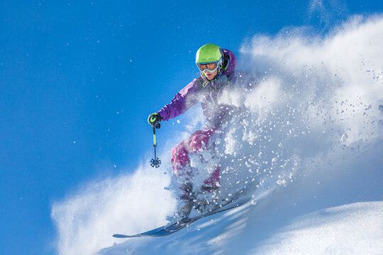 Girl skiing through the fresh snow