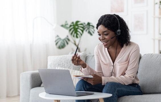Cheerful Black Female Online Tutor Explaining Subject To Student Via Video Call