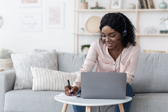 Distance Learning. Positive Black Woman Studying With Laptop And Headset At Home