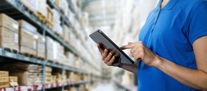 logistics service, warehouse management and inventory concept - female worker using digital tablet in warehouse. copy space