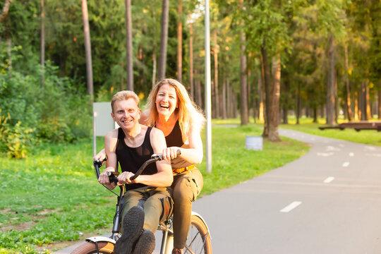 Couple in love on bikes having fun in the park