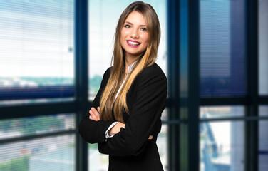 Smiling businesswoman portrait in a modern office