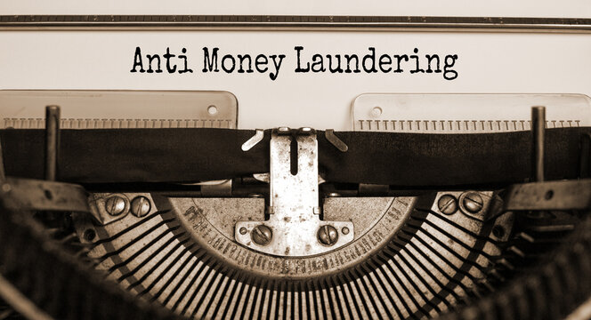 Words 'Anti Money Laundering' typed on retro typewriter. Business concept.