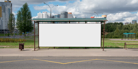 large blank white poster for mockup place in iron frame of bus stop