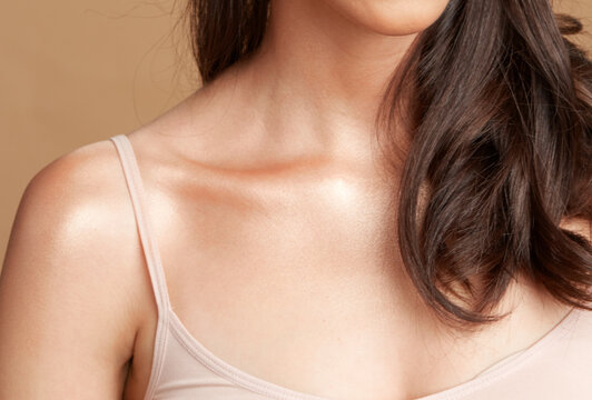 shoulder bone and neck of women with long brown hair
