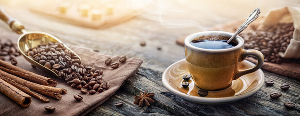 A cup of aromatic black coffee and coffee beans on the table. Morning Coffee Espresso for breakfast...