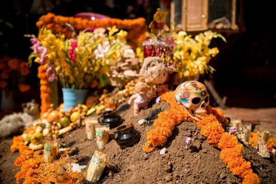 La Santa Muerte Altar with flowers, Lake Patzcuaro, Michoacan, Mexico