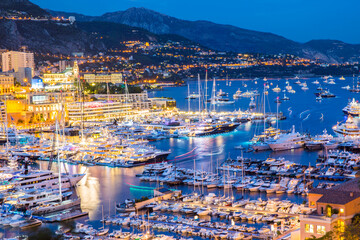 Elevated view of superyachts at Monaco yacht show at dusk
