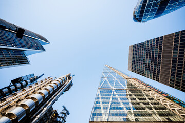Low angle view of blue sky from122 Leadenhall St, The Shard and Gherkin, London, UK