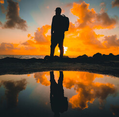 silhouette of a man on sunset photographer sky sun sunset reflection