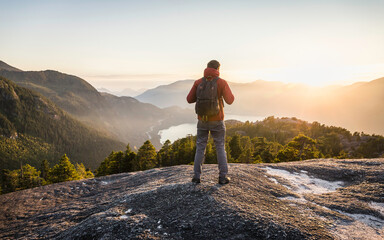 Man standing, looking at view, Stawamus Chief, overlooking Howe Sound Bay, Squamish, British Columbia, Canada