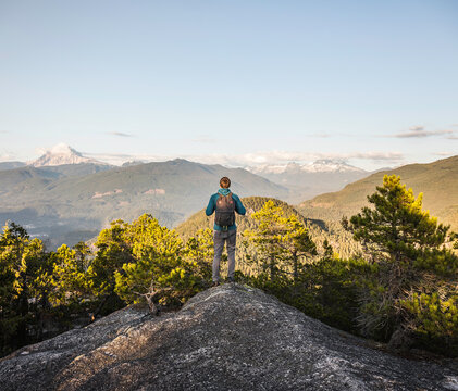Man looking at view, Stawamus Chief, overlooking Howe Sound Bay, Squamish, British Columbia, Canada